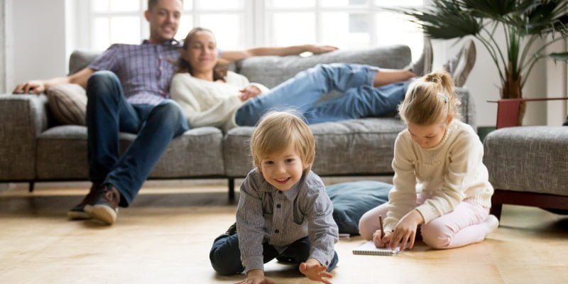 family in living room with underfloor heating